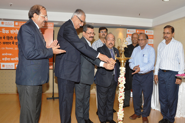 Shri Prabhat Agarwal, (General Manager Bank of Baroda, Resc., WMS & Mktg.) Shri Ranjan Dhawan, Shri B B Joshi & Shri P Srinivas, (Executive Directors of the Bank) all seen lighting the lamp on the occasion of Inter Bank Seminar on Advent of Hindi in Social Media and its role in publicizing Banking.